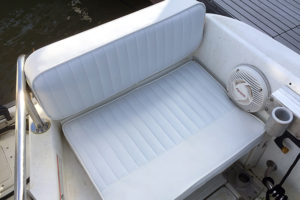 White upholstered boat seat